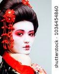 young pretty geisha in black... | Shutterstock . vector #1036454860