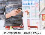 woman shopping at the... | Shutterstock . vector #1036459123