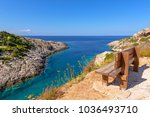 bench on cliff with view of bay ...   Shutterstock . vector #1036493710