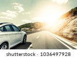 white car rushing along a high... | Shutterstock . vector #1036497928
