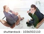 confident business colleagues... | Shutterstock . vector #1036502110