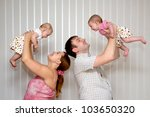 happy mother and father raising ... | Shutterstock . vector #103650320