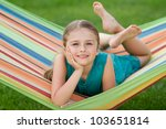 Happy summer - lovely girl in colorful hammock - stock photo