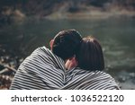 affectionate couple covered... | Shutterstock . vector #1036522120