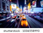 Time Square - New York in movement. Shot of cars in movement with motion blur.