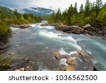 A flowing river in Telemark Norway, flowing from the mountains.