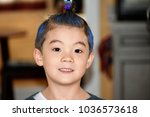 Small photo of Bloomfield, N.J, U.S.A - March 1 2018 : Portrait of a young boy set wacky hair on Wacky hair day for school