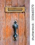 Post Box On The Wooden Door