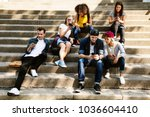 friends sitting on the... | Shutterstock . vector #1036604410