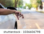 man's hand throwing plastic... | Shutterstock . vector #1036606798