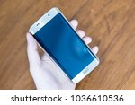 phone in hand use cell phone | Shutterstock . vector #1036610536