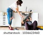 couple fixing kitchen sink | Shutterstock . vector #1036623460