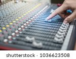Small photo of Hand adjusting audio mixer. sound engineer hands working on sound mixer in live concert.Adjust the volume