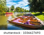 A row of punts on a bright summer