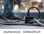 power plug are placed on wet... | Shutterstock . vector #1036629124
