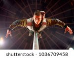 acrobat performing on the arena ... | Shutterstock . vector #1036709458