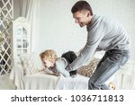 loving father plays with his... | Shutterstock . vector #1036711813