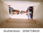 smiling young couple opening a... | Shutterstock . vector #1036718620