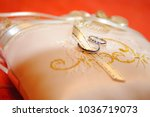wedding rings on a cushion... | Shutterstock . vector #1036719073