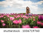 young relaxing in the tulip... | Shutterstock . vector #1036719760