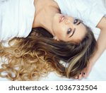 lady with make up relaxing on... | Shutterstock . vector #1036732504