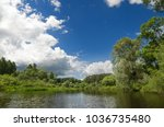 lake with banks overgrown with... | Shutterstock . vector #1036735480