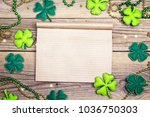 Stock photo blank notepad with clover leaves on wooden boards st patrick s day holiday symbol space for text 1036750303