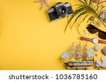 camera and souvenirs from... | Shutterstock . vector #1036785160