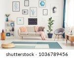 pouf on blue carpet in bright... | Shutterstock . vector #1036789456
