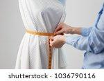 female dressmaker working on... | Shutterstock . vector #1036790116