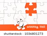 Small photo of Puzzle pieces with a funny face and the text missing link