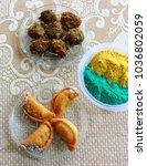holi celebration with snacks ... | Shutterstock . vector #1036802059