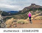 trail running girl in mountains ... | Shutterstock . vector #1036814398