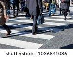 busy pedestrian crossing at...   Shutterstock . vector #1036841086