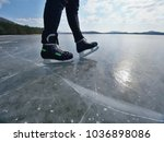 man ice skating on frozen lake. ... | Shutterstock . vector #1036898086