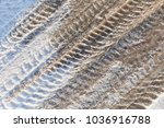tire tracks in the frozen snow  ... | Shutterstock . vector #1036916788