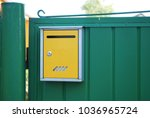Small photo of snail mail postal box on the gate