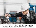 factory engineer checks the... | Shutterstock . vector #1036989208