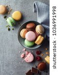 colorful macarons on gray... | Shutterstock . vector #1036991998