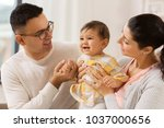family  parenthood and people... | Shutterstock . vector #1037000656