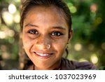 young girl from a small village ...   Shutterstock . vector #1037023969