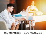 couple relaxing and working... | Shutterstock . vector #1037026288
