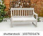 Wooden Bench Covered In Snow