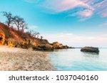 huge stones in the water with... | Shutterstock . vector #1037040160