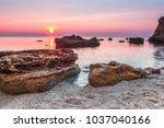 huge stones in the water with... | Shutterstock . vector #1037040166