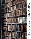 book shelf full of old books at ... | Shutterstock . vector #1037055346