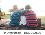 siblings sitting on log with... | Shutterstock . vector #1037062603