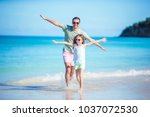 happy father and his adorable... | Shutterstock . vector #1037072530