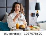 breakfast in bed  cozy hotel... | Shutterstock . vector #1037078620