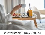 breakfast in bed  cozy hotel... | Shutterstock . vector #1037078764
